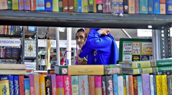 Young girls explore the All-India Urdu Book Fair in Bangalore. –Photo courtesy The Hindu
